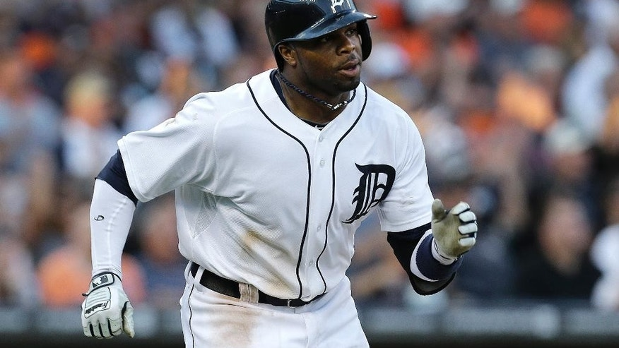 Detroit Tigers' Rajai Davis hits a one-run single against the Los Angeles Dodgers in the third inning of a baseball game in Detroit, Tuesday, July 8, 2014. (AP Photo/Paul Sancya)