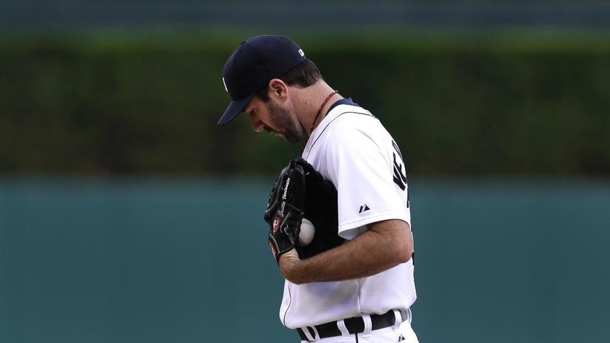 Detroit Tigers pitcher Justin Verlander prepares to throw against the Los Angeles Dodgers in the first inning of a baseball game in Detroit, Tuesday, July 8, 2014. (AP Photo/Paul Sancya)