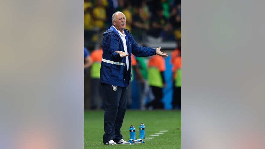 Brazil's coach Luiz Felipe Scolari gestures during the World Cup semifinal soccer match between Brazil and Germany at the Mineirao Stadium in Belo Horizonte, Brazil, Tuesday, July 8, 2014. (AP Photo/Matthias Schrader)