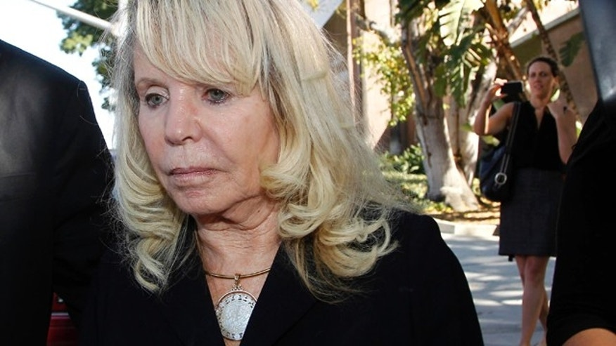 July 7, 2014: Shelly Sterling, the estranged wife of Los Angeles Clippers owner Donald Sterling, leaves a Los Angeles courthouse (AP Photo/Nick Ut)