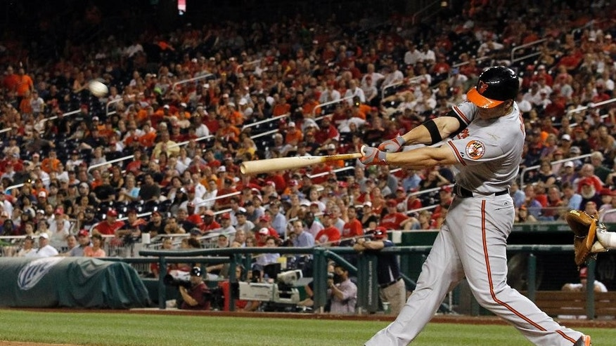 Baltimore Orioles' Chris Davis hits a two-run homer during the 11th inning of an interleague baseball game against the Washington Nationals at Nationals Park, Monday, July 7, 2014, in Washington. The Orioles won 8-2, in 11 innings. (AP Photo/Alex Brandon)