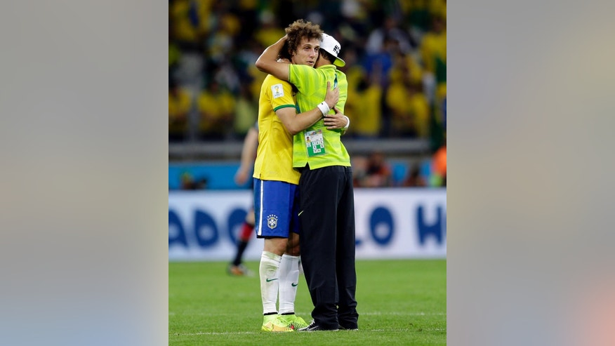 Brazil's David Luiz, left, hugs his teammate Thiago Silva after Germany defeated Brazil 7-1 to advance to the finals during the World Cup semifinal soccer match between Brazil and Germany at the Mineirao Stadium in Belo Horizonte, Brazil, Tuesday, July 8, 2014. (AP Photo/Natacha Pisarenko)