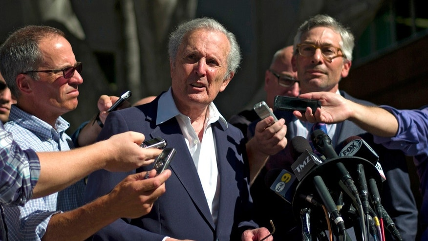 "Bert Fields, center left, an attorney for Shelly Sterling, the wife of Los Angeles Clippers owner Donald Sterling, talks to reporters as he is joined by Adam Streisand, an attorney for former Microsoft CEO Steve Ballmer, outside the Los Angeles Superior Court on Tuesday, July 8, 2014, in Los Angeles. Donald Sterling was testy during his 90-minute appearance Tuesday afternoon, denouncing doctors who declared him to have Alzheimer's disease as ""hired guns,"" pleading a faulty memory about some of his most controversial remarks and repeatedly drawing laughter from spectators during the non-jury trial. (AP Photo/Jae C. Hong)"