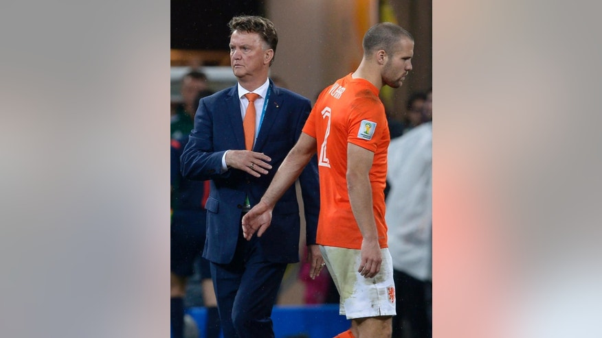 Netherlands' head coach Louis van Gaal greets Ron Vlaar after losing a shootout at the end of the World Cup semifinal soccer match between the Netherlands and Argentina at the Itaquerao Stadium in Sao Paulo Brazil, Wednesday, July 9, 2014. Argentina won 4-2 on penalties after the match ended 0-0 after extra time.  (AP Photo/Manu Fernandez)