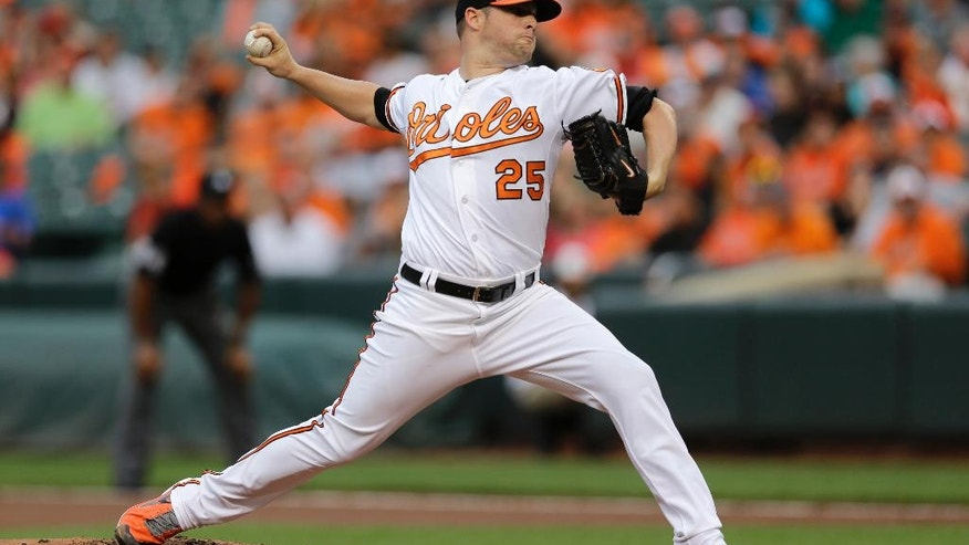 Baltimore Orioles starting pitcher Bud Norris throws to the Washington Nationals in the first inning of an interleague baseball game, Wednesday, July 9, 2014, in Baltimore. (AP Photo/Patrick Semansky)