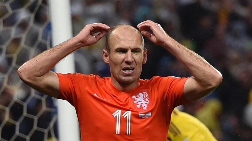 Netherlands' Arjen Robben reacts after missing a chance during the World Cup semifinal soccer match between the Netherlands and Argentina at the Itaquerao Stadium in Sao Paulo Brazil, Wednesday, July 9, 2014. (AP Photo/Martin Meissner)