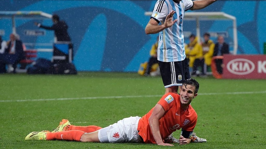 Netherlands' Robin van Persie smiles after missing a chance during the World Cup semifinal soccer match between the Netherlands and Argentina at the Itaquerao Stadium in Sao Paulo Brazil, Wednesday, July 9, 2014. (AP Photo/Manu Fernandez)