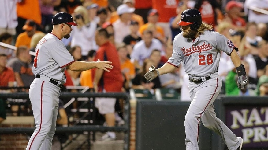 Washington Nationals' Jayson Werth, right, jogs past third base coach Bob Henley as he rounds the bases after hitting a solo home run in the sixth inning of an interleague baseball game against the Baltimore Orioles, Thursday, July 10, 2014, in Baltimore. (AP Photo/Patrick Semansky)