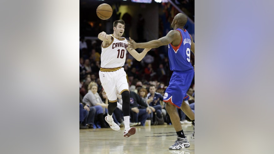 FILE - In this Jan. 7, 2014 file photo, Cleveland Cavaliers' Sergey Karasev (10), from Russia, passes the ball against James Anderson during an NBA basketball game in Cleveland. A person familiar with the deals says the Cavaliers have agreed to trade guard Jarrett Jack, swingman Sergey Karasev and center Tyler Zeller, moves that can help their pursuit of LeBron James by clearing salary cap space. The Cavs have agreements with the Brooklyn Nets and Boston Celtics, according to the person who spoke Wednesday, July 9, 2014, to The Associated Press. The person spoke on condition of anonymity because teams are not permitted to discuss any trades until the league's moratorium ends Thursday.(AP Photo/Tony Dejak)