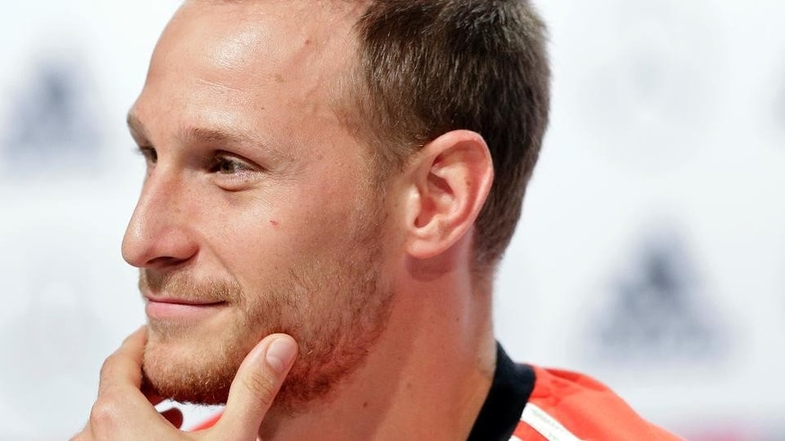 German national soccer player Benedikt Hoewedes attends a news conference in Santo Andre near Porto Seguro, Brazil, Thursday, July 10, 2014. Germany faces Argentina on upcoming Sunday in Maracana Stadium in Rio de Janeiro, in the final of the World Cup. (AP Photo/Matthias Schrader)
