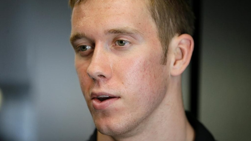 IndyCar driver Jack Hawksworth speaks during an interview, Thursday, July 10, 2014, at Iowa Speedway in Newton, Iowa. Hawksworth suffered a practice crash at Pocono last Saturday that was so severe he wound up in the hospital with a bruised heart but has since been cleared to run in Saturday night's race in Iowa. (AP Photo/Charlie Neibergall)