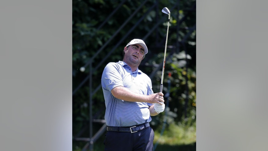 Steven Bowditch, from Australia, watches his tee shot on the 16th hole during the first round of the 2014 John Deere Classic golf tournament at TPC Deere Run in Silvis, Ill., Thursday, July 10 2014. (AP Photo/Charles Rex Arbogast)