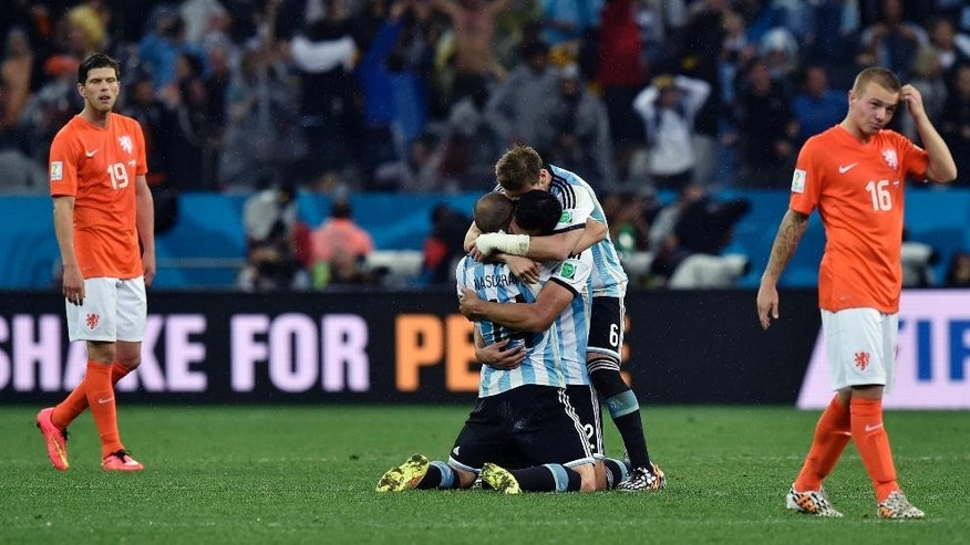 Argentina players celebrate after winning a shootout at the end of the World Cup semifinal soccer match between the Netherlands and Argentina at the Itaquerao Stadium in Sao Paulo Brazil, Wednesday, July 9, 2014. Argentina won 4-2 on penalties after the match ended 0-0 after extra time. (AP Photo/Martin Meissner)