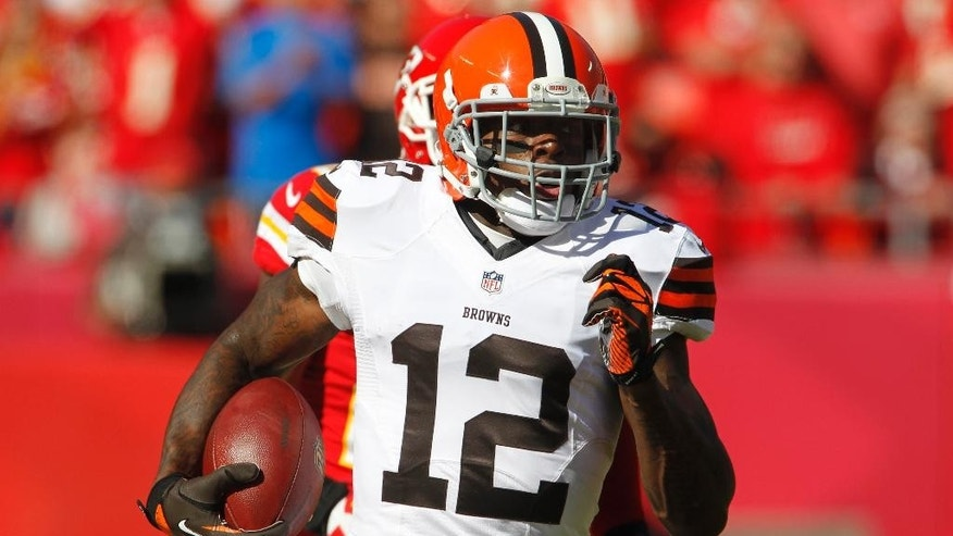 In this Oct. 27, 2013, photo, Cleveland Browns wide receiver Josh Gordon (12) runs during an NFL football game against the Kansas City Chiefs in Kansas City, Mo. Police say Gordon was arrested and charged with driving while intoxicated after speeding down a street in Raleigh, N.C. Police spokesman Jim Sughrue said Gordon was taken into custody after being pulled over for going 50 mph in a 35 mph zone on U.S. 70 in northwest Raleigh around 3 a.m. Saturday, July 5, 2014. Gordon was released on bail. (AP Photo/Colin E. Braley)