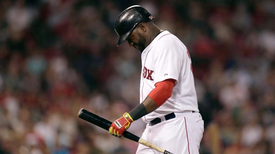 Boston Red Sox designated hitter David Ortiz heads to the dugout after grounding out during the seventh inning of a baseball game against the Chicago White Sox at Fenway Park in Boston, Monday, July 7, 2014. Ortiz grounded out his first three at-bats. (AP Photo/Charles Krupa)