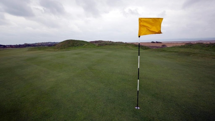 FILE - In this April 23, 2014, file photo, a flag lies on the wind on the 14th hole at Royal Liverpool Golf Club in Hoylake, England. The British Open golf championship begins on Thursday July 17, 2014. (AP Photo/Jon Super, File)