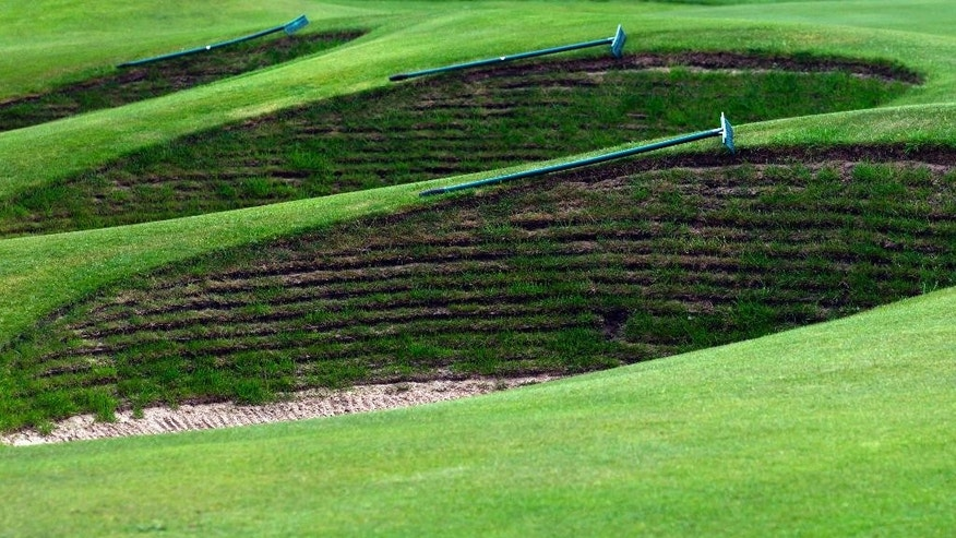 FILE - This April 23, 2014, file photo, shows the bunkers by the 18th green at Royal Liverpool Golf Club before the British Open golf championships in Hoylake, England. The British Open golf championship begins on Thursday July 17, 2014. (AP Photo/Jon Super, File)