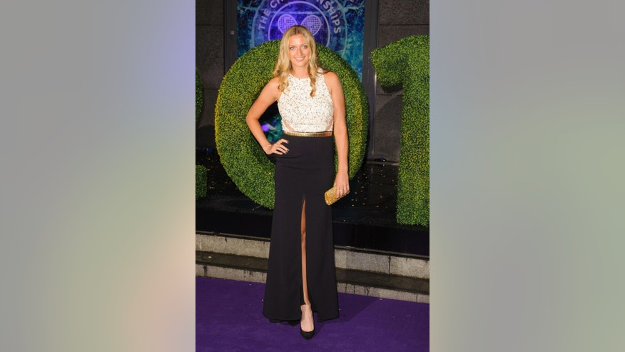 Wimbledon Women's Tennis Singles champion Petra Kvitova arriving at the Wimbledon Champions Dinner 2014, at the Royal Opera House, in Covent Garden, London, Sunday July 6, 2014. (AP Photo/PA, Dominic Lipinski)  UNITED KINGDOM OUT  NO SALES  NO ARCHIVE