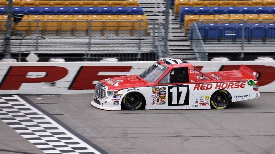 Timothy Peters drives his car during practice for the NASCAR Trucks Series auto race, Friday, July 11, 2014, at Iowa Speedway in Newton, Iowa. (AP Photo/Charlie Neibergall)