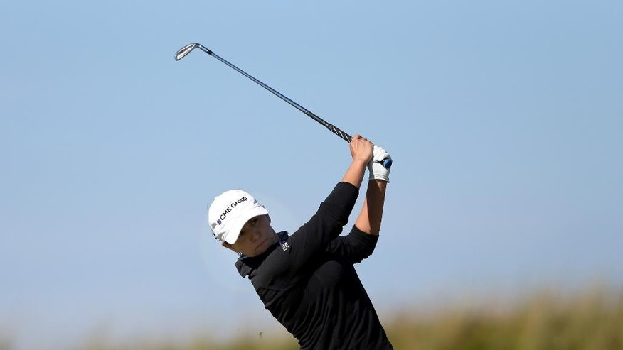 Mo Martin of the US plays a shot on the 9th fairway during the second day of the Women's British Open golf championship on the Royal Birkdale Golf Club, Southport, England, Friday July 11, 2014. (AP Photo/Scott Heppell)