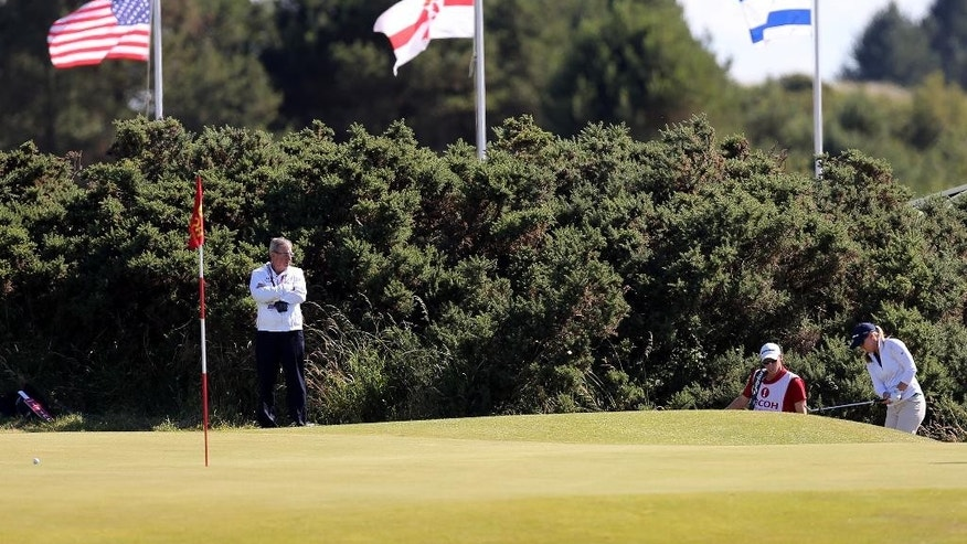 Austin Ernst of the US plays a shot onto the 9th green during the second day of the Women's British Open golf championship on the Royal Birkdale Golf Club, Southport, England, Friday July 11, 2014. (AP Photo/Scott Heppell)