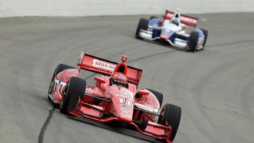 Tony Kanaan (10) drives during practice for the IndyCar Series' Iowa Corn Indy 300 auto race, Friday, July 11, 2014, at Iowa Speedway in Newton, Iowa. (AP Photo/Charlie Neibergall)