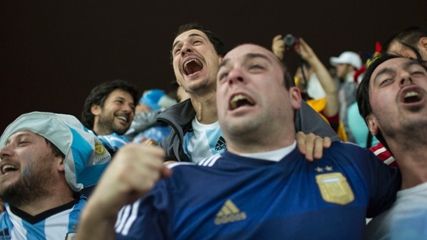 Argentinians celebrate after defeating the Netherlands at the Itaquerao Stadium in Sao Paulo, on July 9, 2014.