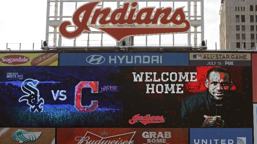 The Progressive Field scoreboard welcomes back LeBron James, during a baseball game between the Chicago White Sox and the Cleveland Indians on Friday, July 11, 2014, in Cleveland. James announced earlier in the day he would return to play for the Cleveland Cavaliers after four years in Miami. (AP Photo/Mark Duncan)