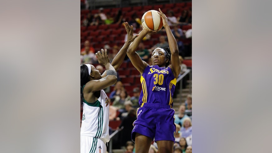 FILE - In this July 3, 2014, file photo, Los Angeles Sparks' Nneka Ogwumike (30) shoots as Seattle Storm's Crystal Langhorne defends during the second half of a WNBA basketball game in Seattle. Nneka will face her sister Chiney when the Sparks play the Connecticut Sun on Sunday. (AP Photo/Elaine Thompson, File)