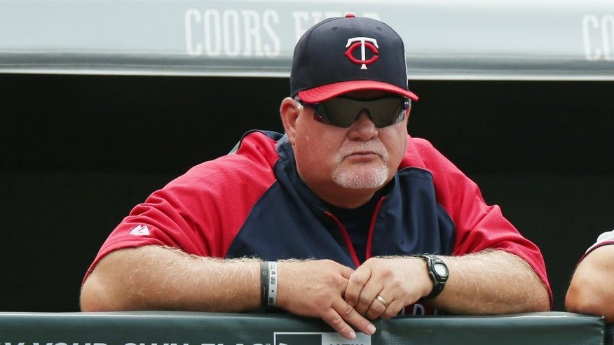 Minnesota Twins manager Ron Gardenhire looks on against the Colorado Rockies in the fourth inning of an interleague baseball game in Denver on Saturday, July 12, 2014. (AP Photo/David Zalubowski)