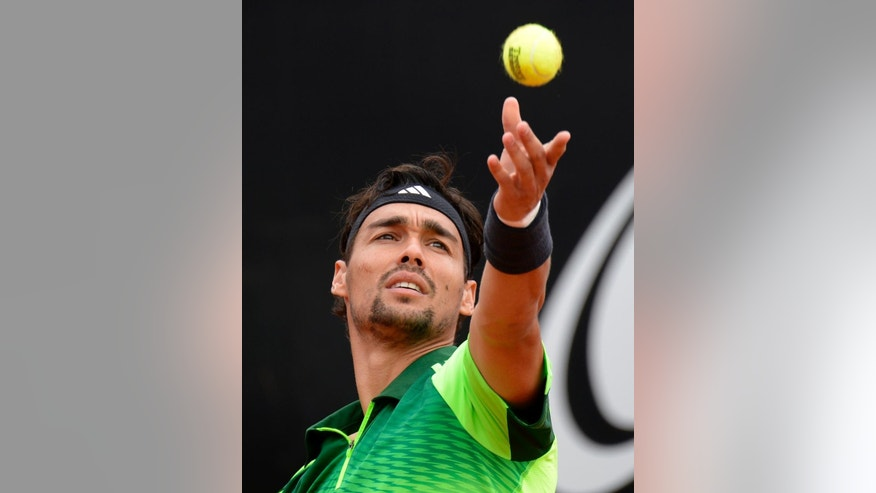 Italy's Fabio Fognini  serves a ball to Roberto Bautista Agut, from Spain,  during their semifinal match of the  Mercedes Cup ATP  tennis tournament in Stuttgart, Germany, Saturday July 12, 2014.   (AP Photo/dpaDaniel Maurer)