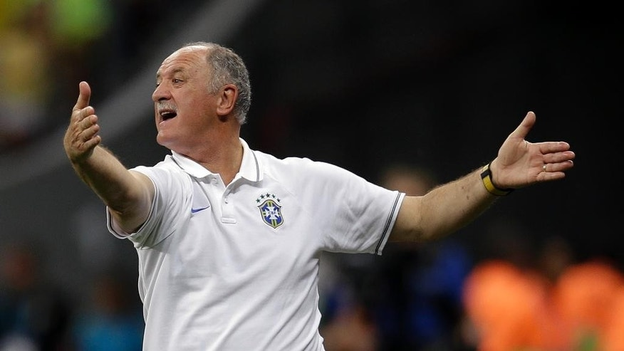Brazil's coach Luiz Felipe Scolari yells instructions to his players during the World Cup third-place soccer match between Brazil and the Netherlands at the Estadio Nacional in Brasilia, Brazil, Saturday, July 12, 2014. (AP Photo/Natacha Pisarenko)