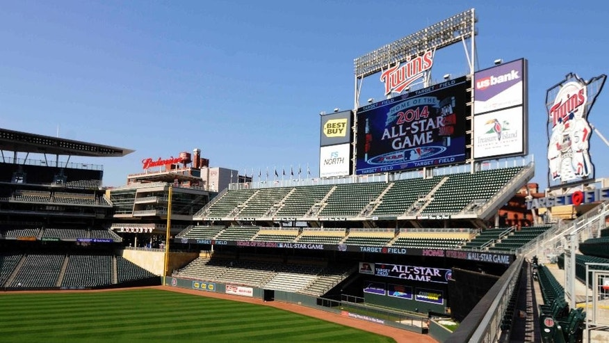 FILE - In this Aug. 29, 2012 file photo, a message showing that the Minnesota Twins will host the 2014 All-Star game at Target Field in Minneapolis is displayed on an outfield video screen after Commissioner Bud Selig made the announcement. Major League Baseball's All Star festivities will be held in the 4-year-old ballpark, the one that helped outdoor baseball make a return to chilly Minnesota.  (AP Photo/Jim Mone, File)