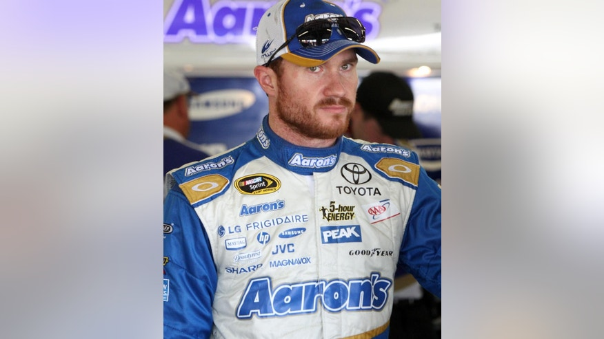 Brian Vickers rests after the morning practice for Sunday's Sprint Cup Series auto race at New Hampshire Motor Speedway, Saturday, July 12, 2014, in Loudon, NH (AP Photo/Jim Cole)