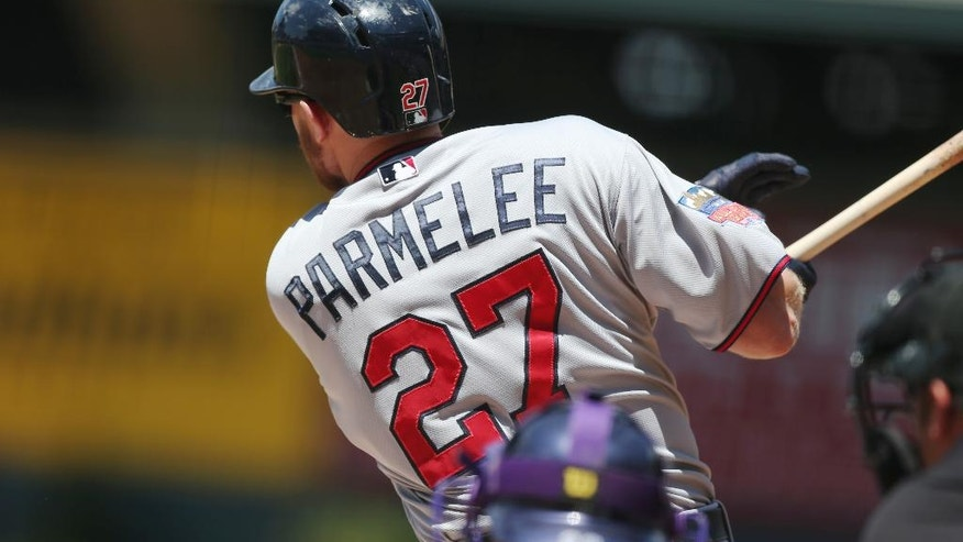 Minnesota Twins' Chris Parmelee singles to drive in two runs against the Colorado Rockies in the first inning of an interleague baseball game in Denver on Sunday, July 13, 2014. (AP Photo/David Zalubowski)