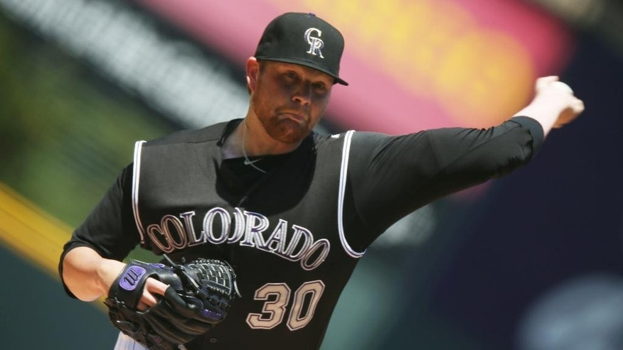 Making his first appearance since being activated off the 60-day disabled list, Colorado Rockies starting pitcher Brett Anderson works against the Minnesota Twins in the first inning of an interleague baseball game in Denver on Sunday, July 13, 2014. (AP Photo/David Zalubowski)