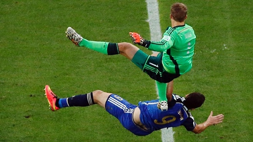 Germany's goalkeeper Manuel Neuer falls over Argentina's Gonzalo Higuain during the World Cup final soccer match between Germany and Argentina at the Maracana Stadium in Rio de Janeiro, Brazil, Sunday, July 13, 2014. (AP Photo/Fabrizio Bensch, Pool)