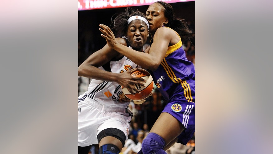 Connecticut Sun's Chiney Ogwumike, left, is guarded by Los Angeles Sparks' Sandrine Gruda, right, during the second half of a WNBA basketball game, Sunday, July 13, 2014, in Uncasville, Conn.  The Sparks won 90-64. (AP Photo/Jessica Hill)