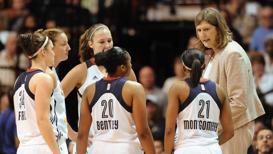 Connecticut Sun head coach Ann Donovan, right, talks to her team during the first half of a WNBA basketball game against the Los Angeles Sparks, Sunday, July 13, 2014, in Uncasville, Conn. The Sparks won 90-64. (AP Photo/Jessica Hill)