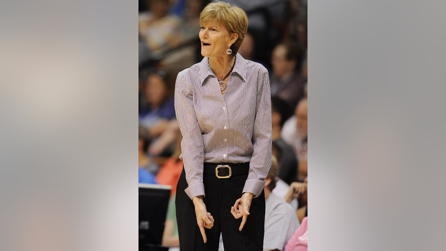 Los Angeles Sparks head coach Carol Ross reacts during the first half of a WNBA basketball game against the Connecticut Sun, Sunday, July 13, 2014, in Uncasville, Conn. The Sparks won 90-64. (AP Photo/Jessica Hill)