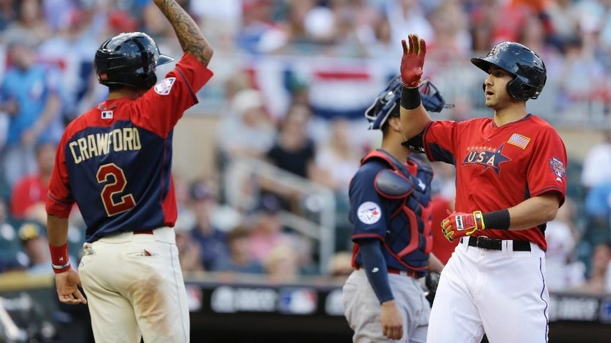 United States' Joey Gallo, right, celebrates with teammate J.P. Crawford, left, after hitting a two-run home run during the sixth inning of the All-Star Futures baseball game against Team World, Sunday, July 13, 2014, in Minneapolis. (AP Photo/Jeff Roberson)