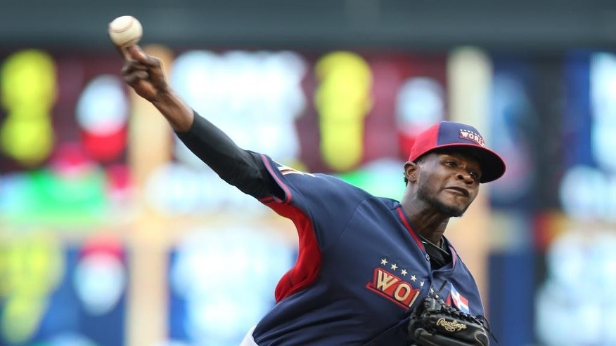 World's pitcher Domingo German throws a pitch during the second inning of the All-Star Futures baseball game against Team United States, Sunday, July 13, 2014, in Minneapolis. (AP Photo/Jim Mone)