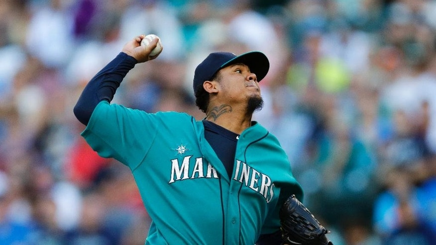 Seattle Mariners starting pitcher Felix Hernandez throws against the Oakland Athletics in the first inning of a baseball game, Friday, July 11, 2014, in Seattle. (AP Photo/Ted S. Warren)