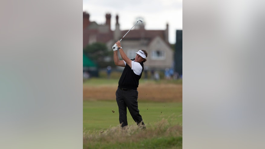 Phil Mickelson of the US plays a shot on the 2nd during a practice round at Royal Liverpool Golf Club prior to the start of the British Open Golf Championship, in Hoylake, England, Monday, July 14, 2014. The 2014 Open Championship starts on Thursday, July 17. (AP Photo/Jon Super)
