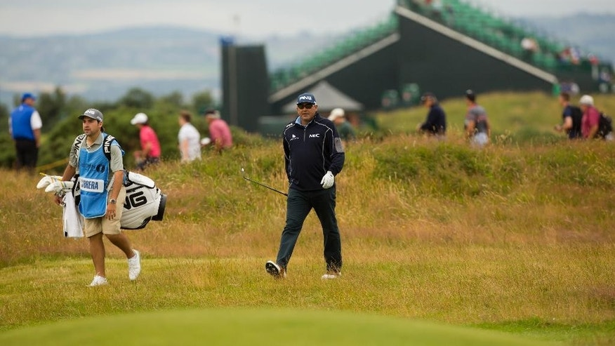 Argentina's Angel Cabrera walks down the 7th fairway during a practice round at Royal Liverpool Golf Club prior to the start of the British Open Golf Championship, in Hoylake, England, Monday, July 14, 2014. The 2014 Open Championship starts on Thursday, July 17. (AP Photo/Jon Super)