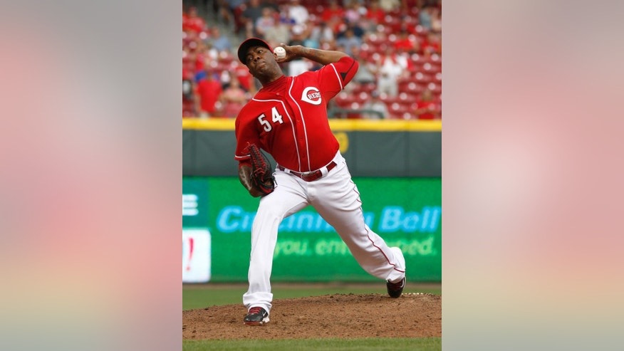 Cincinnati Reds relief pitcher Aroldis Chapman throws against the Pittsburgh Pirates in the ninth inning of a baseball game, Sunday, July 13, 2014, in Cincinnati. The Reds won 6-3. (AP Photo/David Kohl)