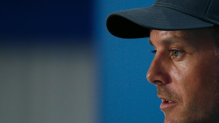 Henrik Stenson of Sweden talks during a press conference ahead of the British Open Golf championship at the Royal Liverpool golf club, Hoylake, England, Wednesday July 16, 2014. The British Open Golf championship starts Thursday July 17. (AP Photo/Alastair Grant)