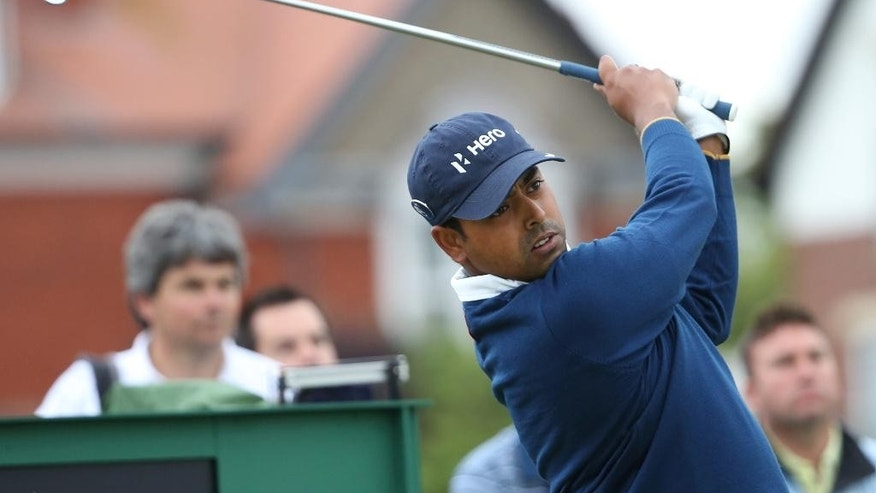Anirban Lahiri of India plays a shot off the 3rd tee during a practice round ahead of the British Open Golf championship at the Royal Liverpool golf club, Hoylake, England, Wednesday July 16, 2014. The British Open Golf championship starts Thursday July 17. (AP Photo/Scott Heppell)