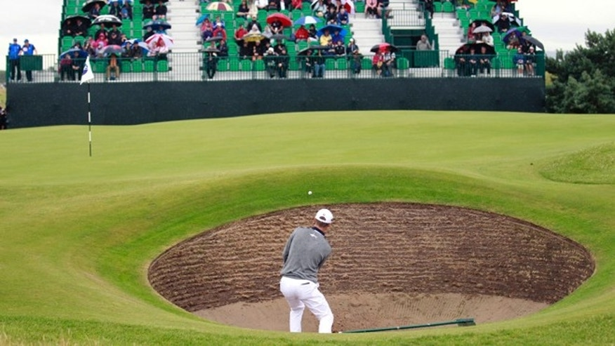 John Senden of Australia plays out of the bunker onto the 6th green during a practice round ahead of the British Open Golf championship at the Royal Liverpool golf club, Hoylake, England, Wednesday July 16, 2014. The British Open Golf championship starts Thursday July 17.