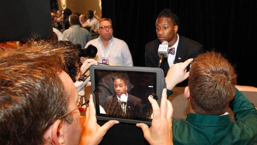 Georgia tailback Todd Gurley speaks to the media at the Southeastern Conference NCAA college football media days, Thursday, July 17, 2014, in Hoover, Ala. (AP Photo/Butch Dill)